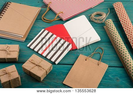 Set With Handmade Striped Shopping Bag, Gift Bags, Packing Paper With Polka Dots, Notepads On Blue W
