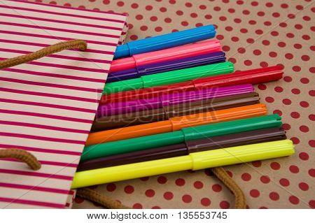 Striped Shopping Bag, Gift Bags, Desk Accessories, Colored Felt-tip Pens On Craft  Paper Background