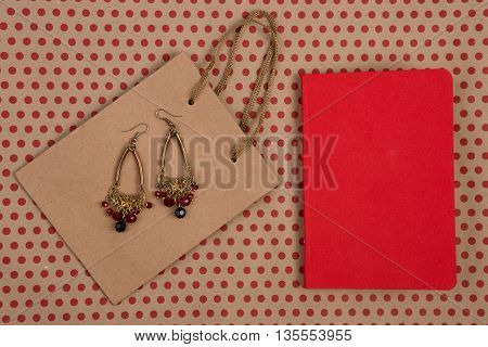 Handmade Shopping Bag Of Craft Paper, Gift Bags, Red Notepad And Women's Jewelry On Craft  Paper Bac