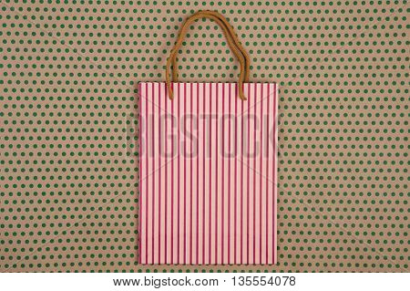 Handmade Striped Shopping Bag, Gift Bags On Craft  Paper Background In Green Polka Dots