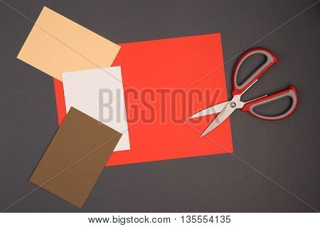 Scissors And Color Paper On Grey Background