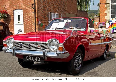 AMERSHAM, UK - SEPTEMBER 7: An iconic vintage Ford Corsair is lined up on the High Street alongside other classic vehicles at the annual Amersham Heritage Day show on September 7, 2014 in Amersham