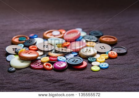 Close up of beautiful color button on fabric.
