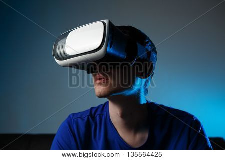 Man wearing virtual reality goggles.