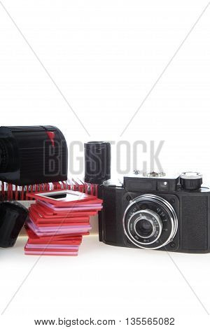 Old slides camera and projector isolated on white background