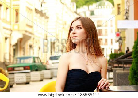 beautiful blonde woman in prom dress in the city