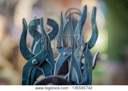 A set of antique vintage tongs and pliers closeup