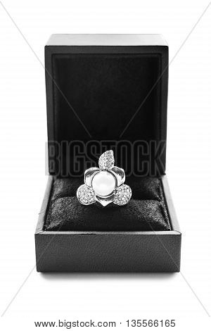 Pearl and diamond ring in black jewel box on white background