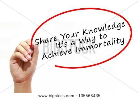 Man Hand writing Share Your Knowledge. Its a Way to Achieve Immortality with marker on transparent wipe board. Business internet technology concept.