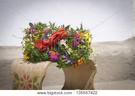wreath of wild flowers mint and green leaves