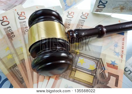 A judge's legal gavel on Euro bills