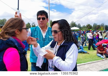 QUITO, ECUADOR - JULY 7, 2015: At pope Francisco mass in Ecuador, everyone takes the communion, a volunteers helping people.