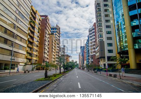 QUITO, ECUADOR - JULY 7, 2015: Republica del Salvador, important avenue of the city, commercial and bussines part.