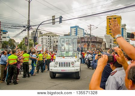 QUITO, ECUADOR - JULY 7, 2015: Lots of people expecting to say hello to pope Francisco in Ecuador, popemobile.