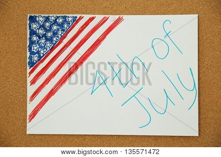 Child's drawing of American flag on cork board