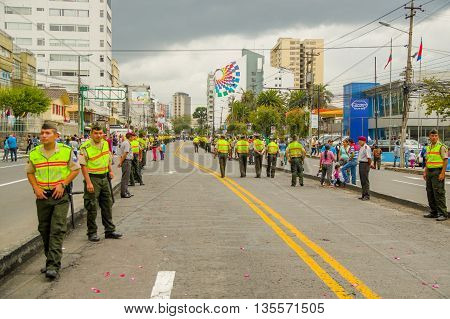 QUITO, ECUADOR - JULY 7, 2015: After Francisco pope passed trough the street, police control the street.