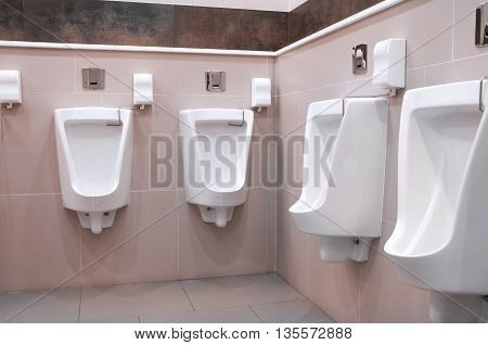 The urine of many white men in a bathroom.
