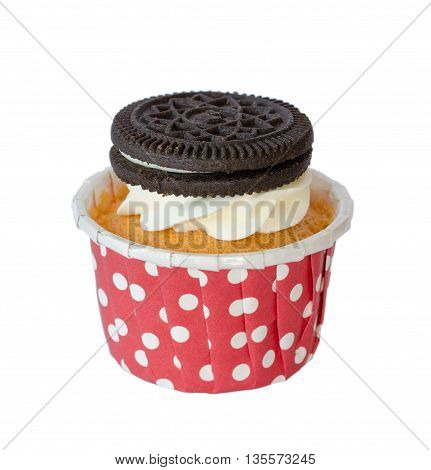 Fluffy choco cupcake with vanilla cream and cookies isolated on the white background with clipping path