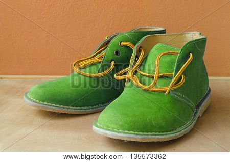 Casual green suede shoes A shoestring yellow green suede classic style luxury Casual accommodation on the wooden floor
