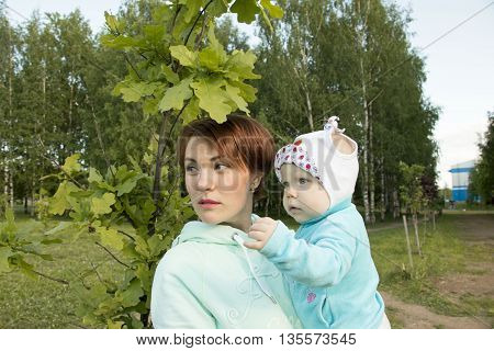 Small Child And His Mom Outdoor In Summer Day