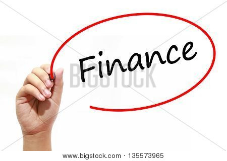 Man Hand writing Finance with marker on transparent wipe board. Business internet technology concept.
