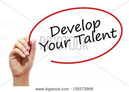 Man Hand writing Develop Your Talent with marker on transparent wipe board. Business internet technology concept.