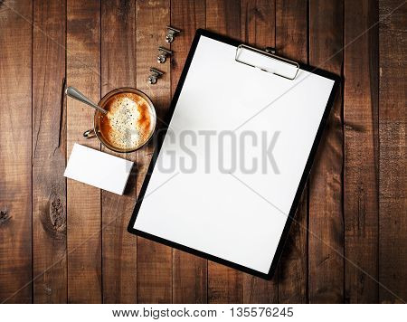 Photo of blank stationery on vintage wooden table background. Blank corporate identity template. Blank branding mock-up. Mockup for design portfolios. Top view.
