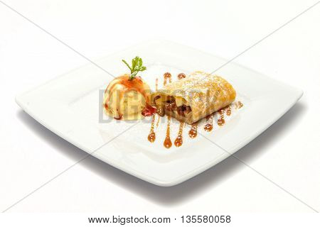 apple strudel with ice cream under the undermining of sugar and caramel topping