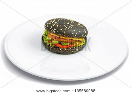 cheeseburger black pastry with sesame seeds chicken burgers cheese cucumbers and tomatoes