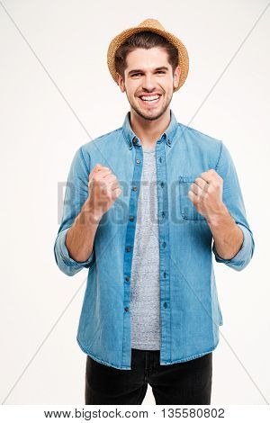 Casual handsome young man rejoices isolated on the white background