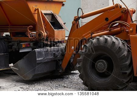 asphalt is loaded into the bucket excavator