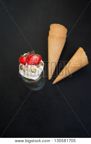 ice cream with fresh strawberry and pistachio nuts