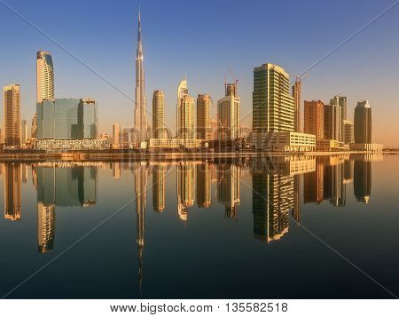 Panoramic view of Business bay and downtown area of Dubai, reflection in a river, UAE.