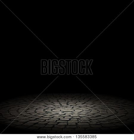 illuminated stone floor on a black background