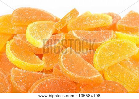 Heap Of Orange And Lemon Candy Slices On A White