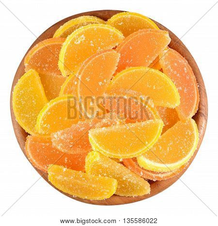 Orange And Lemon Candy Slices In A Wooden Bowl On A White