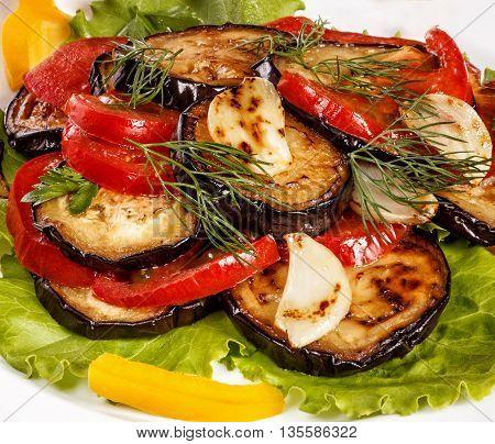 frefresh roasted eggplant on salad leaves with tomatoessh roasted eggplant