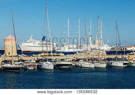 Cruise ship and yacht in bay of Mandraki. Rhodes, Greece