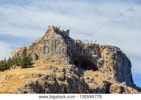 Acropolis of Lindos bottom view of bay of Rhodes Greece summer sunny weather with clouds