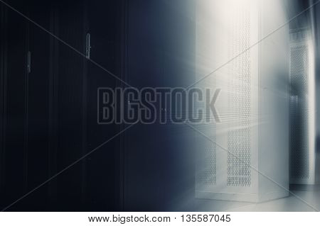 server room with rows of modern equipment and wardrobes mainframes