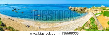 The wide panorama of the scenic sand beach in Caesarea National Park Israel.