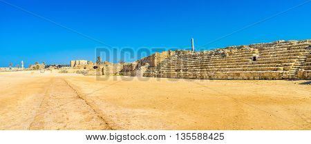 The large hippodrome with preserved stone tribune is one of the central landmarks of Caesarea National Park Israel.