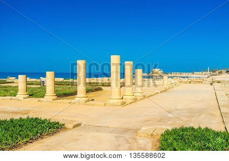 The old foundation and ruined columns are the only preserved parts of the ancient Temple in Caesarea Israel.