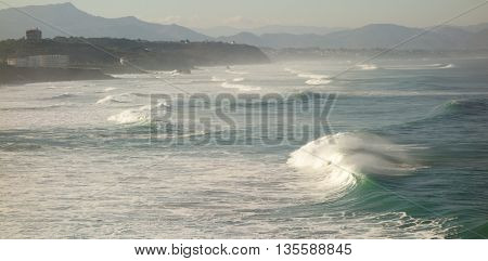 Breaking waves / surf at Biarritz, with Pyrenees in distance