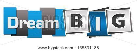 Dream big text written over blue grey background.