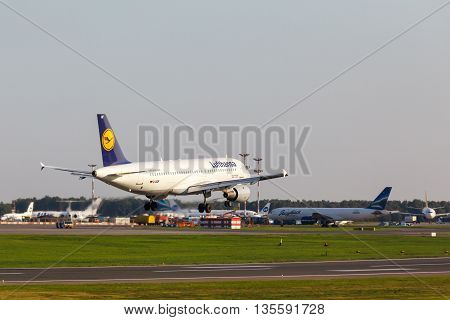 VNUKOVO, MOSCOW REGION, RUSSIA - 02 July, 2013: Airplanes at Vnukovo international airport. Lufthansa Airlines A320 landing to runway