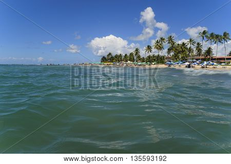 Caribbean blue sea landscape from water surface level summer vacation background.