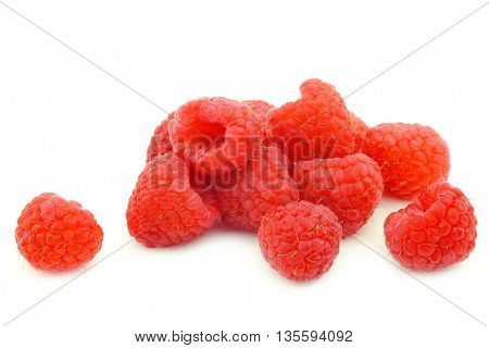 bunch  of fresh raspberries on a white background