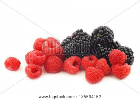 bunch of blackberries and raspberries  on a white background