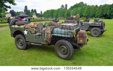 Silsoe, Bedfordshire, England - May 30, 2016: World War 2 Jeeps with  mounted Machine guns parked on grass.